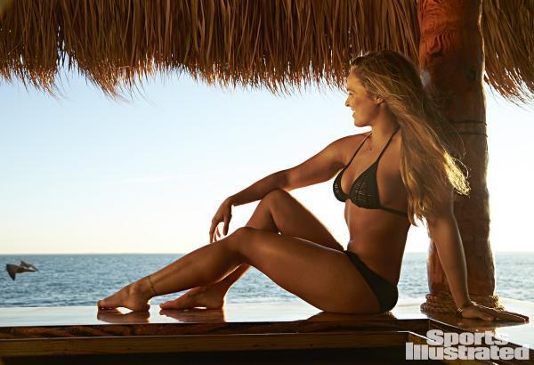 ronda rousey poses in a bikini at the beach