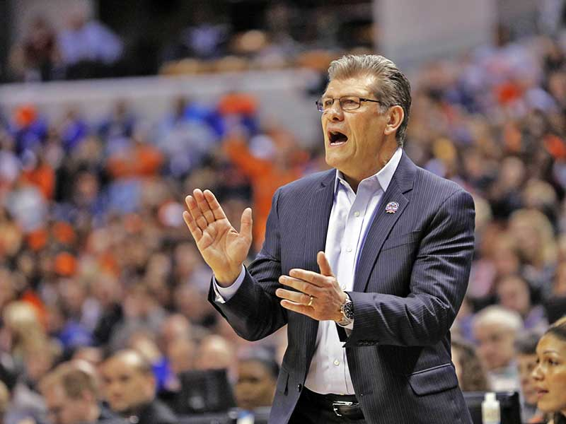 Coach Geno Auriemma clapping in the game