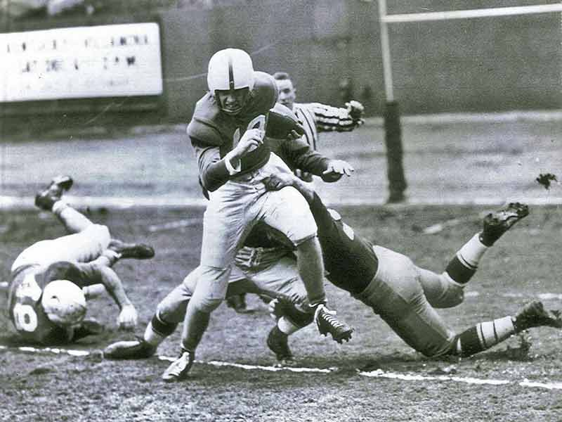 The Kentucky Wildcats' Jim Howe to the 15-yard line in The Great Lakes Bowl game in 1947