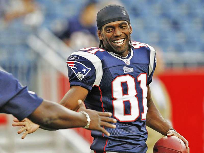 Randy Moss of Patriots giving a handshake in the field