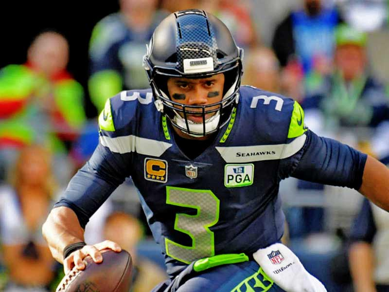 Russell Wilson of Seahawks playing in the field