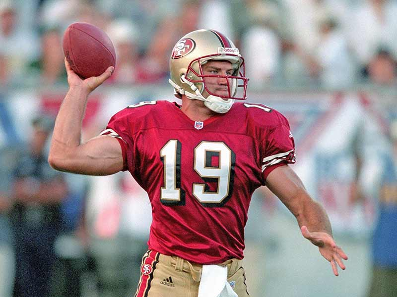 Giovanni Carmazzi of 49ers throwing the ball